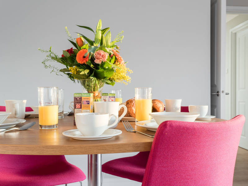 The dining table set up for breakfast in PREMIER SUITES Reading