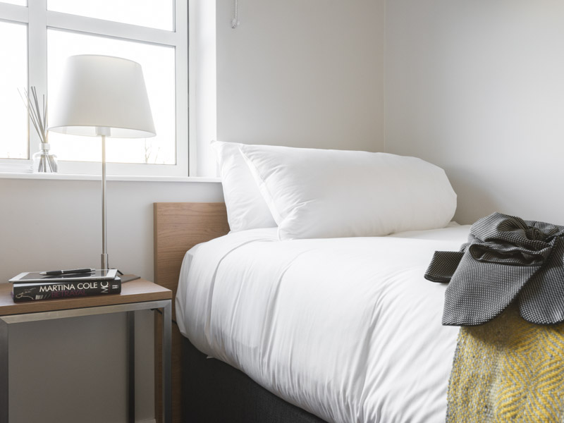A single bed in PREMIER SUITES Reading  modern serviced apartment