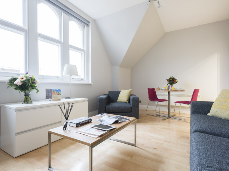 The living room area in the serviced apartments  of PREMIER SUITES Newcastle