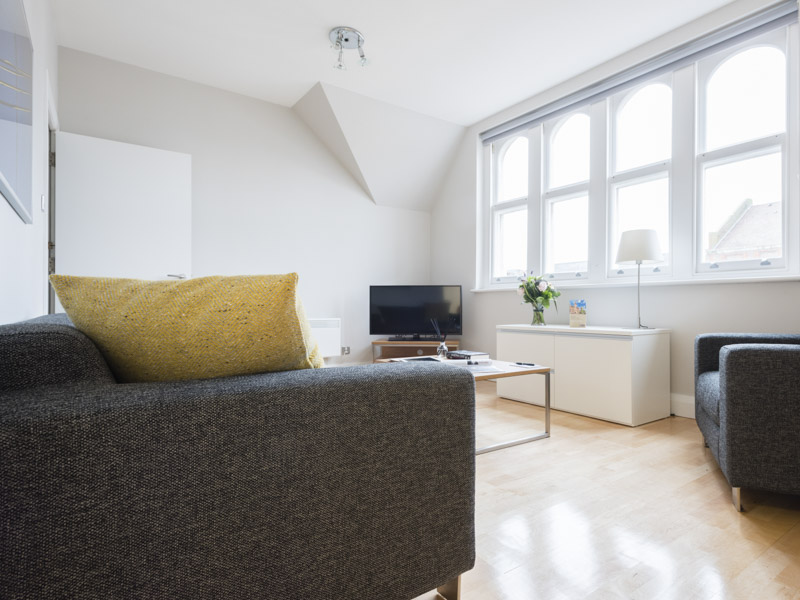 Open plan living room in PREMIER SUITES Reading  serviced apartments
