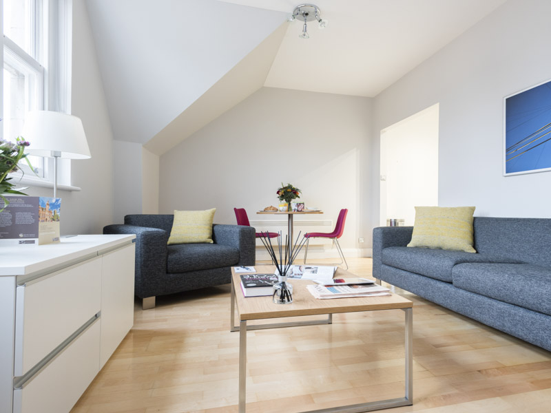 The living area in PREMIER SUITES Reading open plan serviced apartments