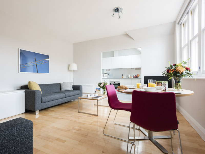 The dining and living area in PREMIER SUITES Reading serviced apartments
